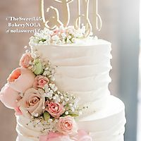 Horizontal lines buttercream with fresh cascading flowers top tier_1